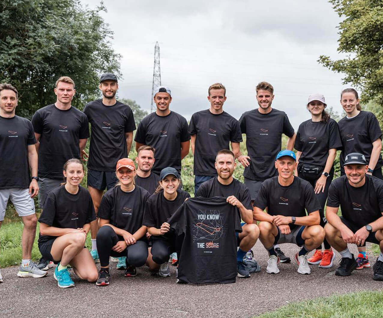 runners posing with kilometre club limited edition t shirt designs